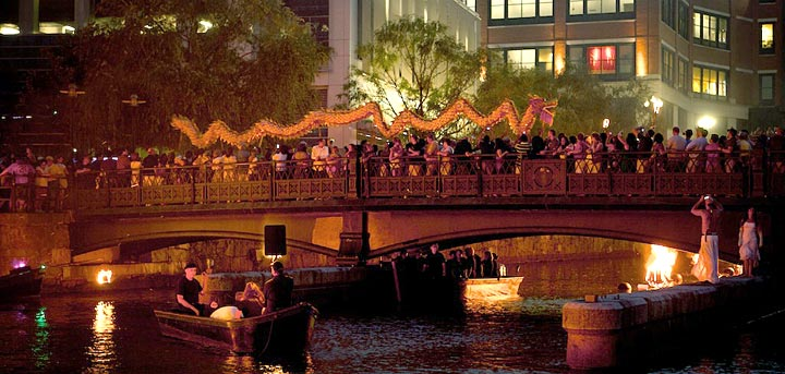 A Chinese dragon delights the crowd in the basin of Waterplace Park. Photo by James Turner.