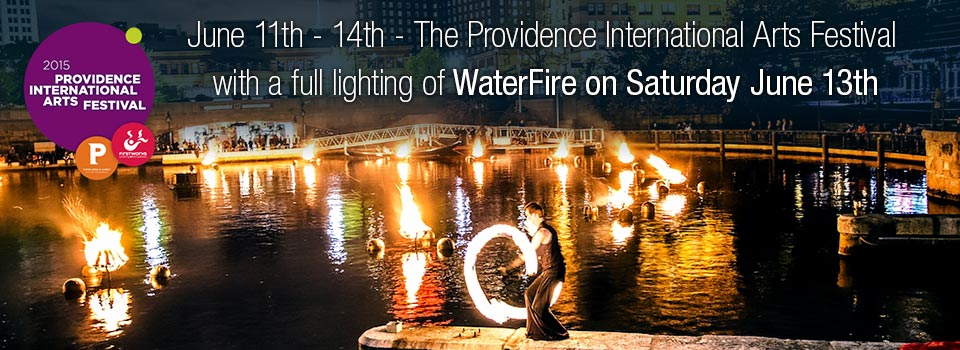 Fire spinner on the Waterplace Basin piers, photo by Jeffrey Stolzberg.