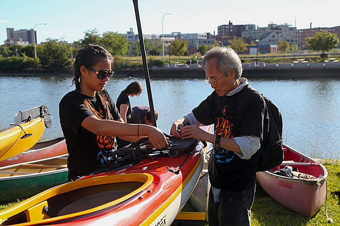 Volunteers prepping kayaks for the 2012 Clear Currents event. Photo by Erin Smithers.
