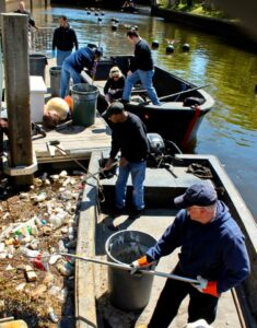 Volunteers cleaning the river near the Gondola Dock.