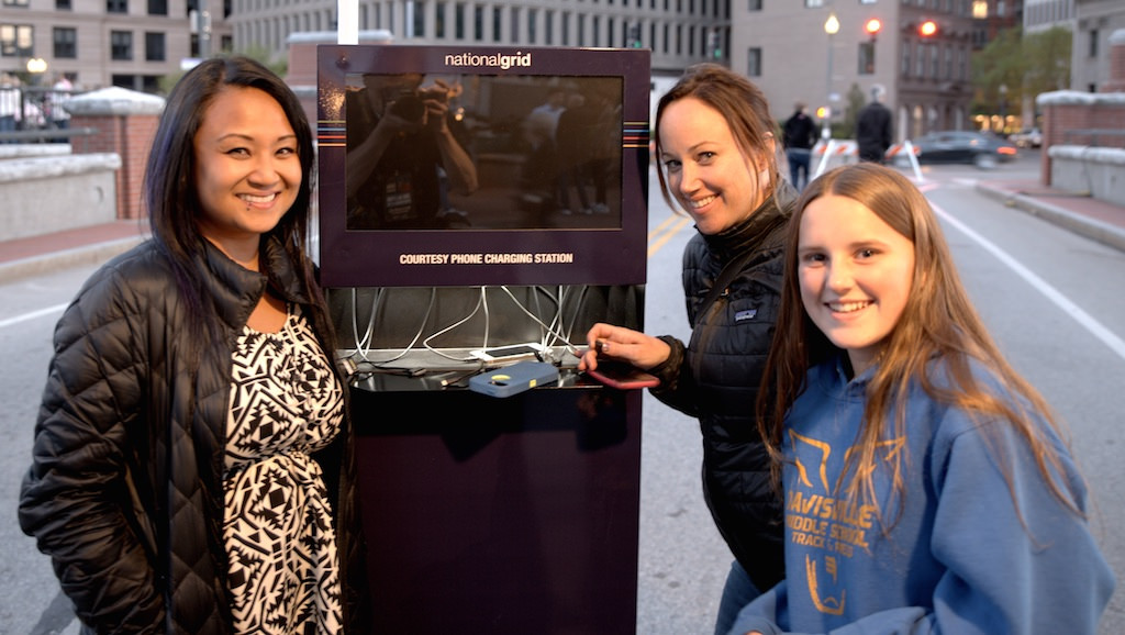 Visitors make use of a National Grid Courtesy Phone Charging Station. Photo by John Nickerson.
