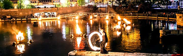 Fire spinner on the Waterplace Basin piers. Photo by Jeffrey Stolzberg.
