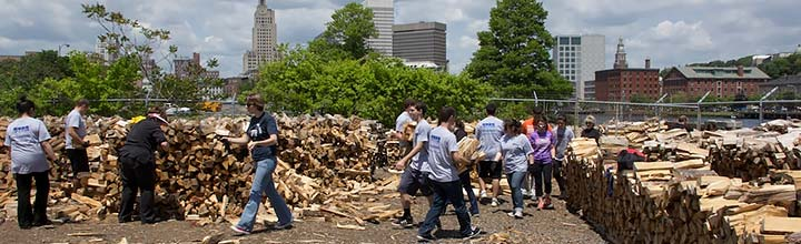 Volunteers at a woodpile workout. Photo by Emily Gauvin.