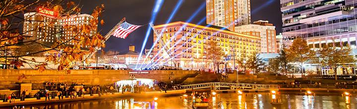 American Flag flies over the Basin during the WaterFire Salute to Veterans. Photo by Jeffrey Stolzberg.