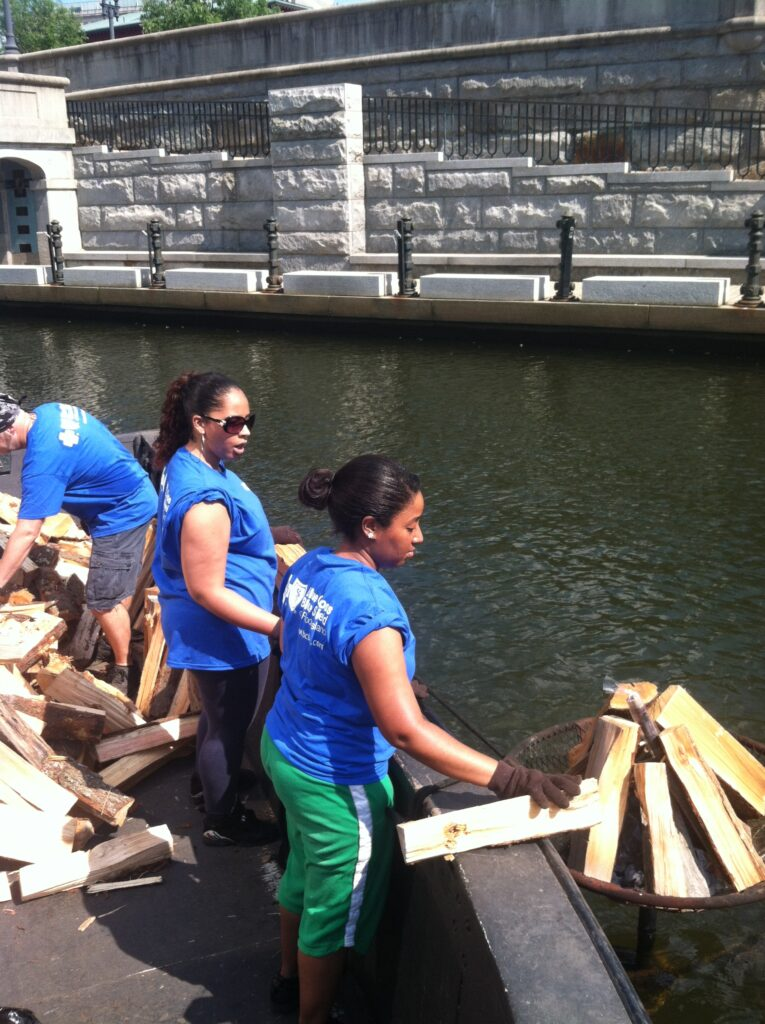 BCBSRI volunteers work on their tans and build their community at WaterFire Providence. Photo by Gary St. Laurent.