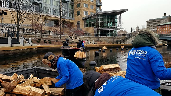 Volunteers from BCBSRI lend a hand leading up to one of our late fall WaterFire lightings. Photo by Gary St. Laurent.