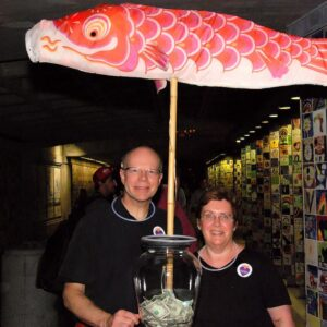 Wayne and Catherine Barnes in the basin tunnel with a fish. Photo by John Nickerson.