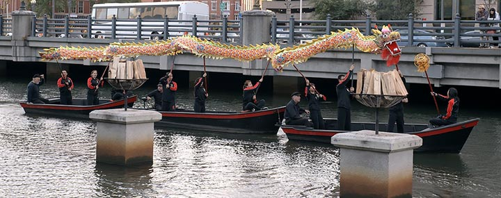 Chinese Dragon Dance performance on three WaterFire boats. Steven Sondler is piloting the center vessel. Photo by John Nickerson.