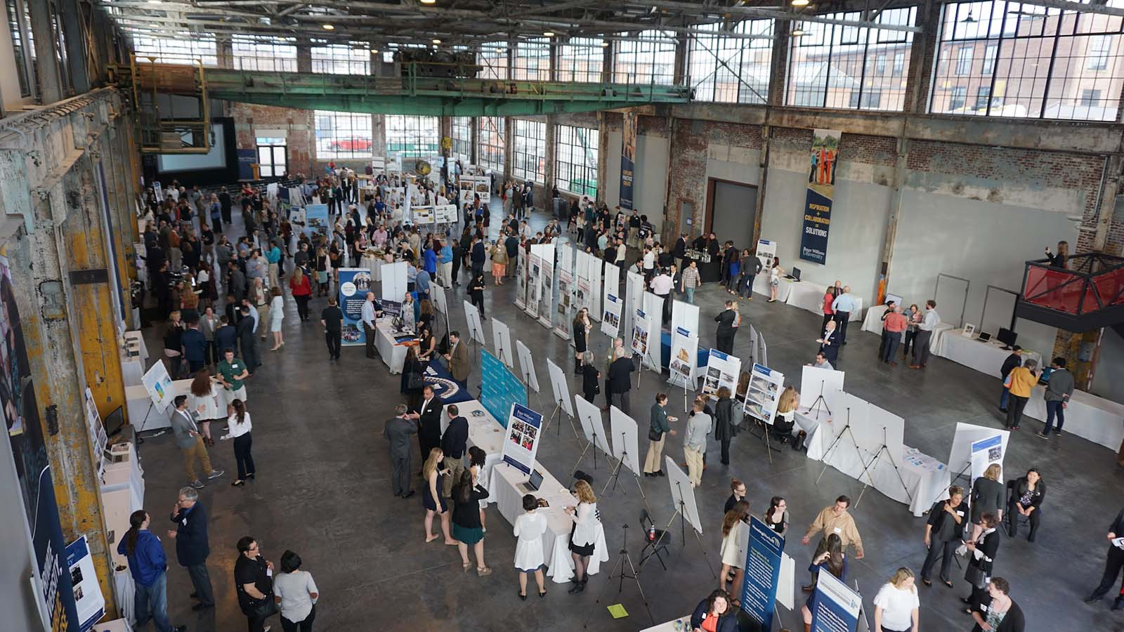 A trade show event in the Main Hall at the WaterFire Arts Center. Photograph by Laura Duclos.