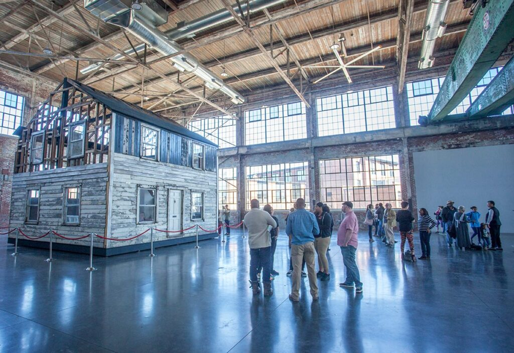 Photograph of the Rosa Parks House Project in the Main Hall at the WaterFire Arts Center. Photograph by Erin Cuddigan.