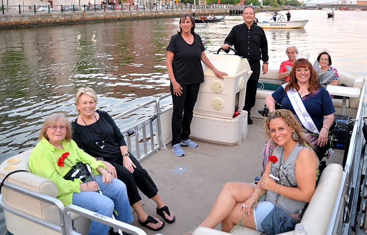 Ms. Wheelchair Rhode Island and other WaterFire visitors enjoy the first Access Boat ride of the 2018 WaterFire Providence season. Photograph by John Nickerson.