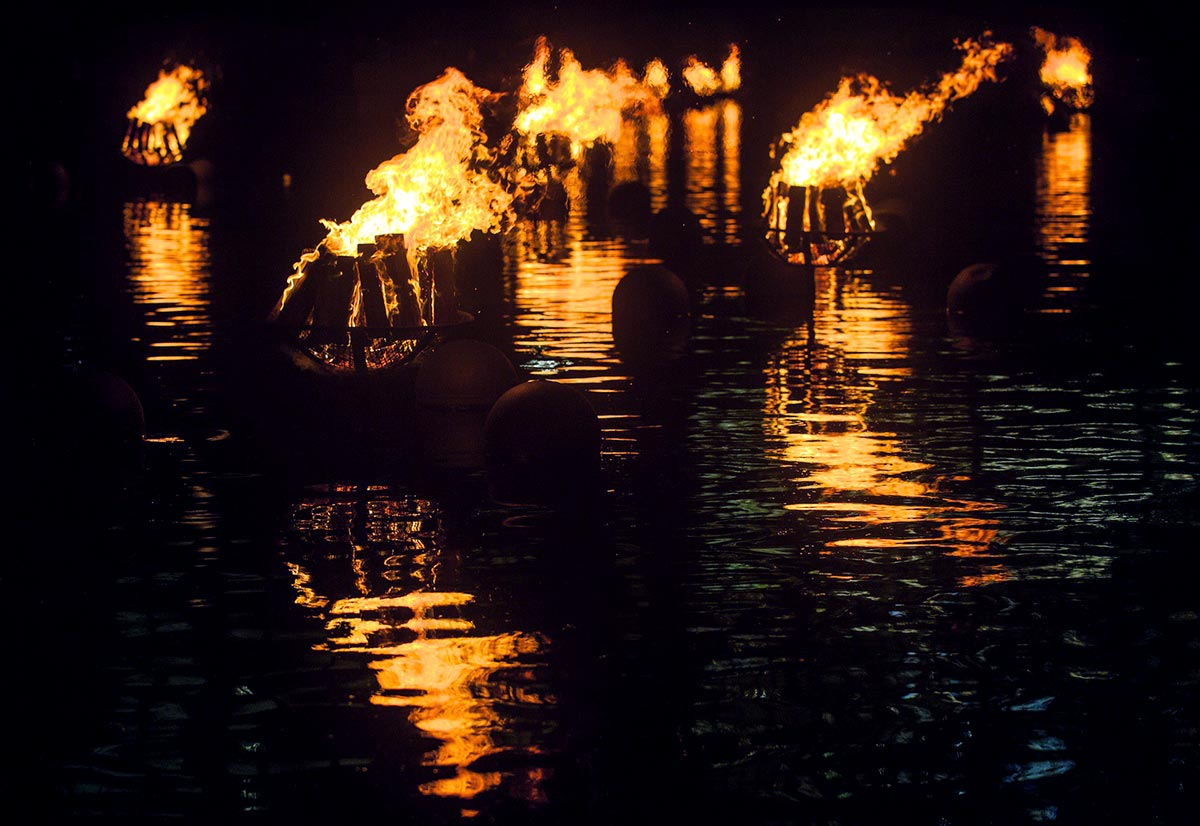 Burning braziers, at WaterFire in Providence, Rhode Island. Photograph by Erin Cuddigan.