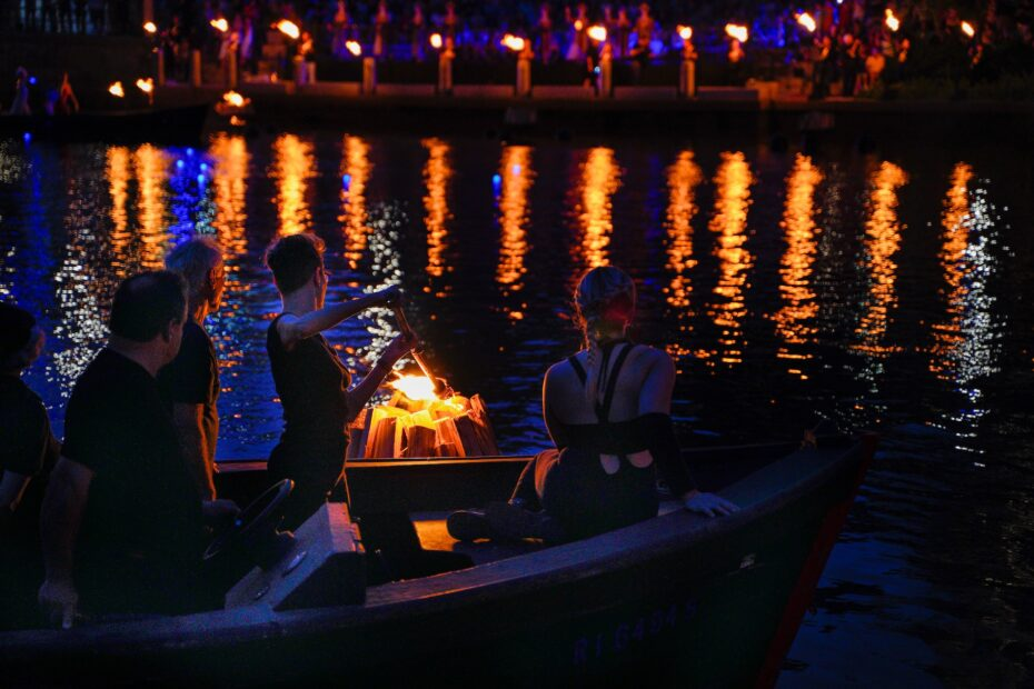 Torches light up Waterplace Basin during a WaterFire lighting. Photograph by Laura Patton.