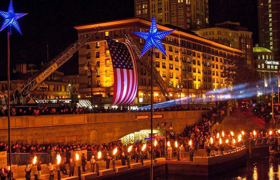 The American Flag flying over Waterplace Basin. Photograph by Max Dowgiallo.