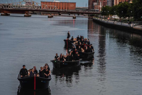 Light boat procession lining up at WaterFire in 2019. Photograph by Luis Andrade.