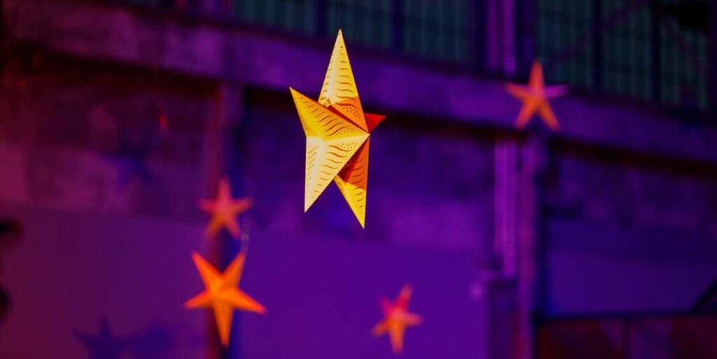 Stars hang at the WaterFire Ars Center as part of the Beacon of Hope Installation. Photograph by Jeff Meunier.