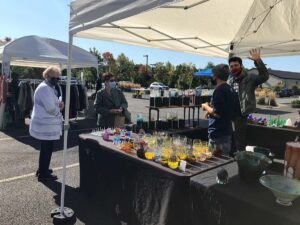 Visitors check out the wares at the Gather Glass booth during an ArtMart market in 2020.
