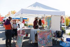 Local artist Syd Soussa's booth at one of last year's ArtMart markets. Photograph by Matthew TW Huang Photography.